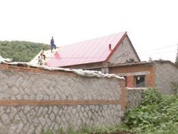 为农村贫困残疾人修缮房屋